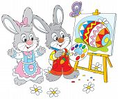 pic of cony  - Little rabbits drawing a colorful Easter egg on a canvas - JPG