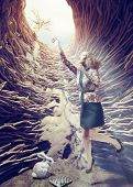Girl flies out of a deep hole toward the sunlight. Creative concept