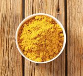image of garam masala  - overhead view of bowl with curry powder - JPG