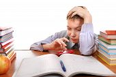 picture of boring  - Bored Kid plays with a Toy on the School Desk on the white background - JPG