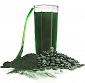 Spirulina  algae powder glass drink nutritional supplement close up , isolated on white background