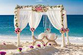 picture of wedding arch  - beach wedding set up - JPG