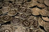 image of ebusiness  - A large pile of bitcoins stacked on top of each other - JPG