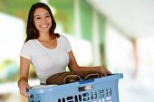 picture of laundry  - Woman who is doing laundry in her home - JPG