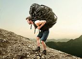 pic of carry-on luggage  - hiker carries a heavy and big backpack - JPG