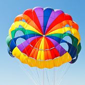 foto of parasailing  - canopy of parachute for parasailing in blue sky - JPG
