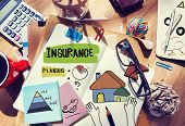 stock photo of messy  - Messy Desk with Insurance Related Notes - JPG