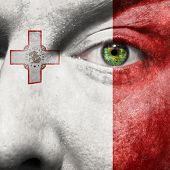 picture of maltese-cross  - Flag painted on face with green eye to show Malta support - JPG