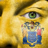 image of ceres  - Flag painted on face with green eye to show New Jersey support - JPG