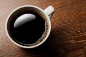 stock photo of peppy  - cup of black coffee on the oak desk - JPG
