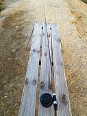 foto of fly rod  - Fly fishing rod on a frost covered bench in winter - JPG