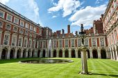 pic of fountain grass  - The Fountain Court designed by Sir Christopher Wren at Hampton Court Palace near London - JPG