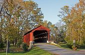 picture of covered bridge  - Pool Forge Covered Bridge in Autumn Lancaster County Pennsylvania USA - JPG