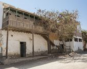 foto of derelict  - Old derelict abandoned building with wooden balcony in an african egyptian town - JPG
