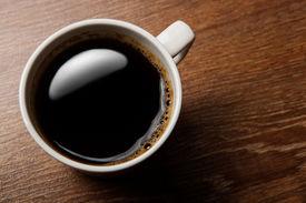 image of peppy  - cup of black coffee on the oak desk - JPG