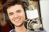 picture of recording studio  - Portrait of an university student recording audio in a studio of a radio - JPG