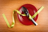 foto of marsala  - simple table setting with green ribbon and marsala plate - JPG