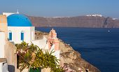 picture of cupola  - Iconic church with blue cupola and pink bell tower in Oia Santorini Cyclades Greece - JPG