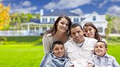 stock photo of hispanic  - Happy Young Hispanic Family in Front of Their New Home - JPG