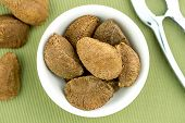 pic of brazil nut  - Brazil nuts in bowl with nut cracker - JPG