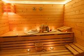 stock photo of sauna  - Interior of a wooden sauna with sauna accessories - JPG