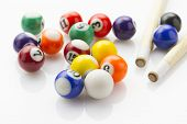 stock photo of snooker  - sport snooker balls with cues laying on white reflective background - JPG
