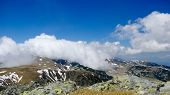 image of blue ridge mountains  - Alpine landscape in Carpathians mountains. Mountain ridge surrounded by beautiful clouds on the blue sky. ** Note: Soft Focus at 100%, best at smaller sizes - JPG