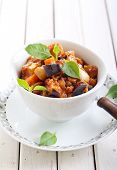 foto of zucchini  - Vegetable stew made of zucchini eggplant carrot in tomato sauce - JPG
