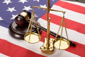pic of jury  - Justice Scale And Wooden Brown Gavel On Usa Flag - JPG