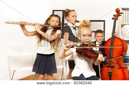School children play musical instruments