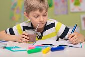 image of school lunch  - School child doing homework and drinking cacao - JPG