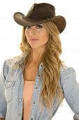 stock photo of cowgirls  - A cowgirl in her western hat with a playful expression - JPG