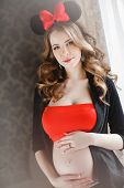 picture of hair bow  - Young beautiful pregnant woman - JPG
