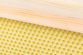 stock photo of foundation  - Background of waxed plastic beehive foundation and frame - JPG