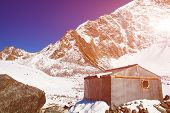 picture of snow capped mountains  - House and Snow capped mountains - JPG