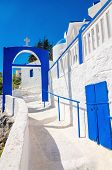 pic of greek  - A view of a Greek church with iconic blue and white stairs against clear blue sky on Greek island - JPG