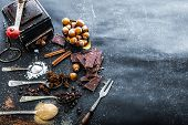 pic of chocolate spoon  - Sweet spices in the spoons and chocolate on a table black - JPG