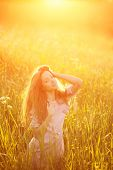picture of allergy  - Young hipster model woman Casual Girl in field in Sunset in spring - JPG