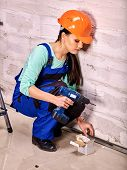 picture of millwright  - Happy family in blue builder uniform drilled wall - JPG