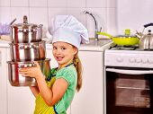 pic of apron  - Child wearing hat and apron cooking at kitchen - JPG
