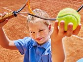 image of balls  - Child girl with racket and ball on  tennis court - JPG