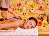 image of stone-therapy  - Happy woman getting stone therapy massage in spa - JPG