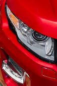 picture of headlight  - Headlight with led lamps and hood of red sport modern car - JPG