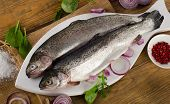 foto of trout fishing  - Raw Rainbow trouts on a wooden table - JPG