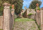 foto of leghorn  - path stairway in entrance to the catholic church of the country village Nugola - JPG