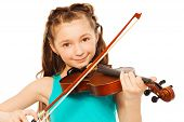 stock photo of violin  - Beautiful girl with long hair holding the fiddle - JPG