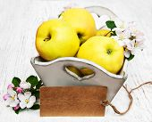 picture of apple blossom  - box with apples and apple tree blossoms and empty tag on a wooden table - JPG