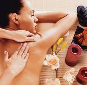 pic of spa massage  - Adult woman in spa salon having body relaxing massage - JPG