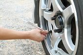 stock photo of air pressure gauge  - Check the tire pressure for safety drive - JPG