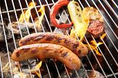image of grilled sausage  - sausages and grilled vegetables on the grill close up - JPG